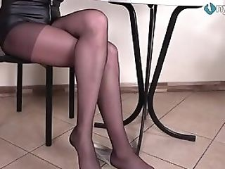 Long-legged Dark-haired In Pantyhose Shoeplay And Feet Taunting