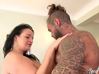 Matures Lady With Gigantic Natural Tits Sucking Dick Of Handy Tatooed Stud